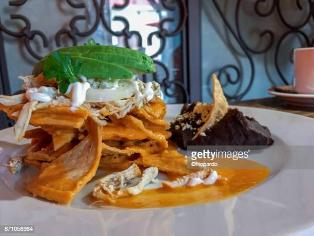 mexican tasty chilaquiles - mole sauce stock pictures, royalty-free photos & images