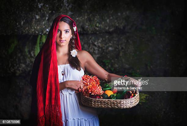 Mexican teenager with flowers and fruits