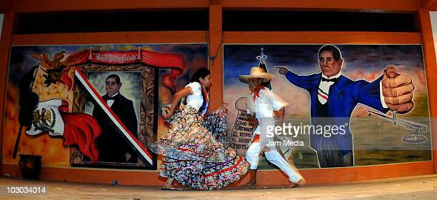 Mexican tehuana dances with a men during the Convite en Laollaga as part of the festivities in Isthmus of Tehuantepec know as Las Velas del Istmo at...