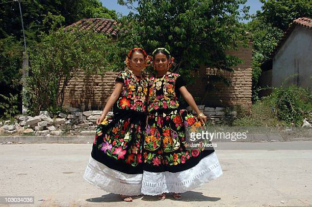 Mexican tehuana poses for a photograph al dressed to take part in the Convite en Laollaga as part of the festivities in Isthmus of Tehuantepec know...