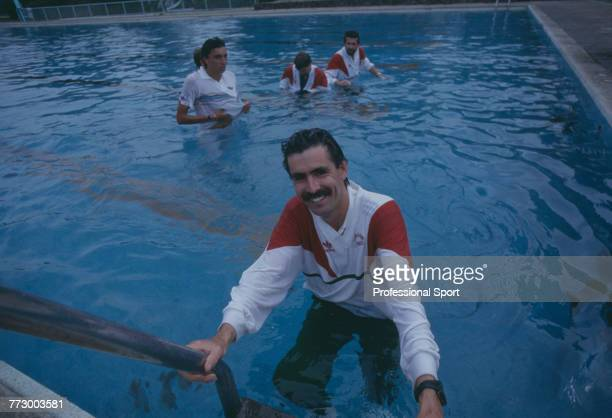 Mexican tennis player and Mexico Davis Cup team captian Raul Ramirez pictured climbing out of a swimming pool prior to the 1987 Davis Cup World Group...
