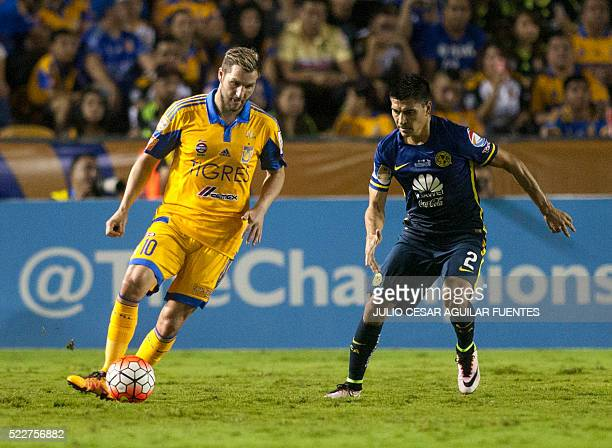 Mexican Tigres' player Andre Pierre Gignac vies for the ball with Paolo Goltz of Mexico's America during the firs leg of the final of the Concacaf...