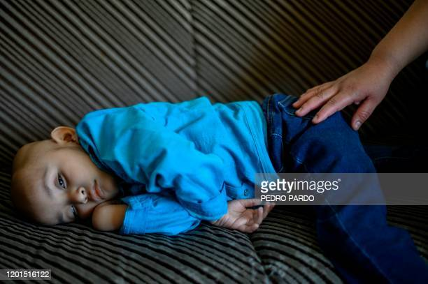 Mexican toddler Cristal Flores, diagnosed with cancer, rests on a couch at a relative's house, in Cuautitlan, Mexico, on February 12, 2020. - The...