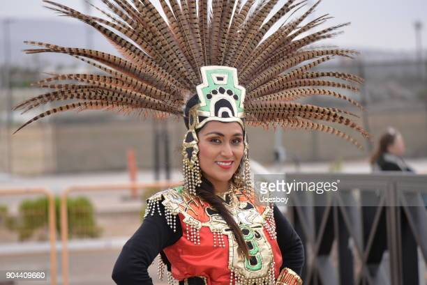 mexican tourist guide in aztec costume - aztec civilization stock photos and pictures