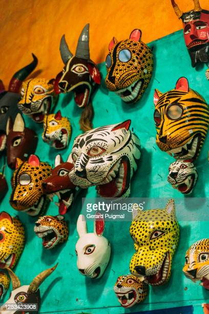 """mexican traditional animal masks hanging on a colourful wall - """"gerard puigmal"""" stock pictures, royalty-free photos & images"""