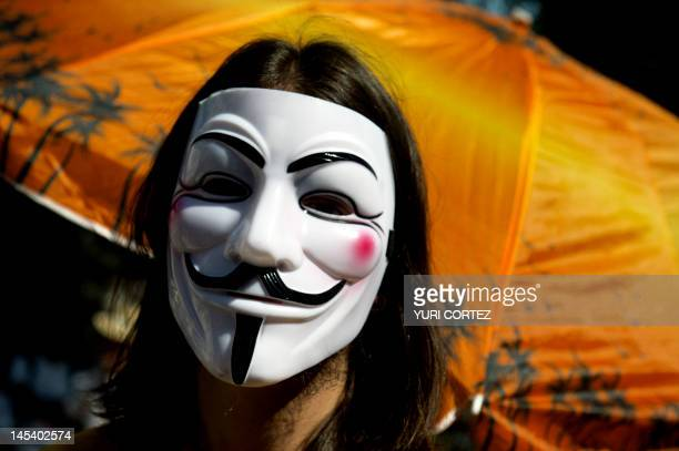 A Mexican university student member of the new movement called 'Yo soy 132' uses a Guy Fawkes mask during a demonstration to demand the TV...