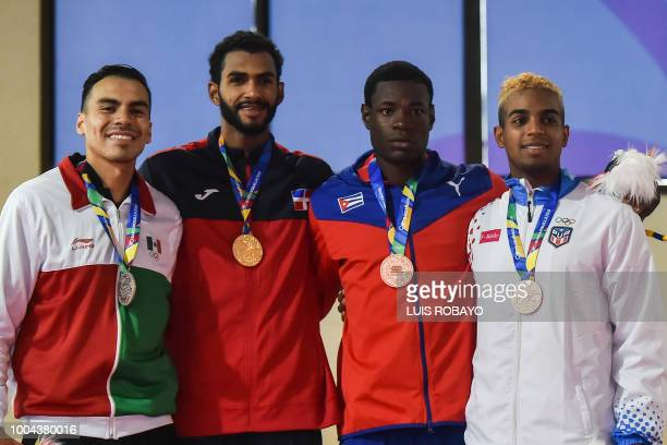 Mexican Uriel Adriano Dominican Moises Hernandez Cuban Erlandi Mustelier and Puerto Rican Elvis Barbosa pose with their medals after the men's...