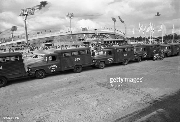 Mexican versions of police 'paddy wagons' are lined up across the street from the Olympic Stadiumjust in caseas the 1968 Olympics get under way with...