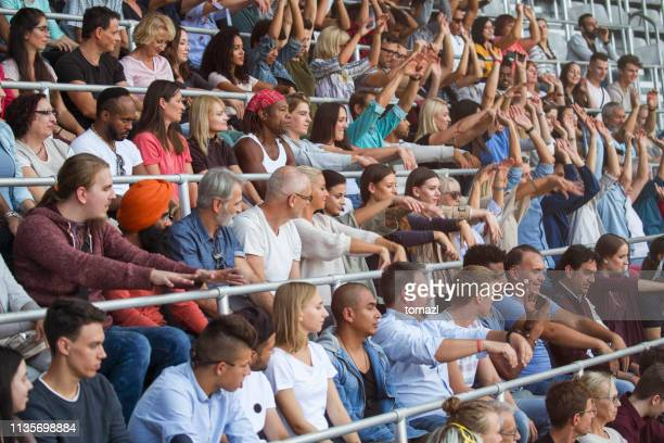 mexican wave on stadium - crowd doing the wave stock pictures, royalty-free photos & images