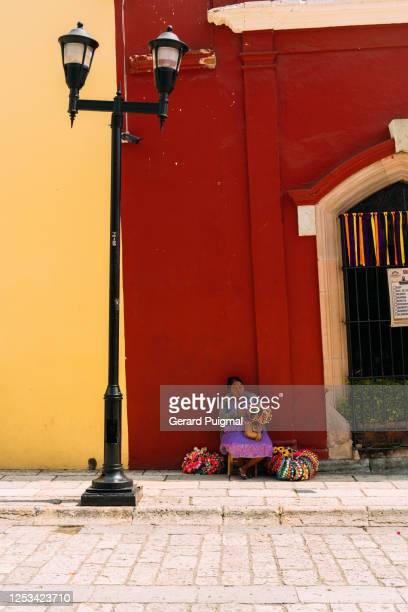 """mexican woman doing flower crowns in main street of oaxaca (oaxaca state, mexico) - """"gerard puigmal"""" stock pictures, royalty-free photos & images"""