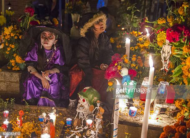 Mexican woman in a cemetery during Day of the Dead in Oaxaca Mexico