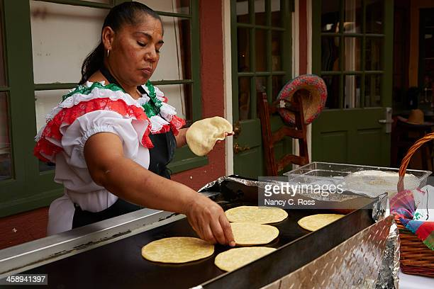mexican woman prepares tortillas on open griddle - old town san diego stock pictures, royalty-free photos & images