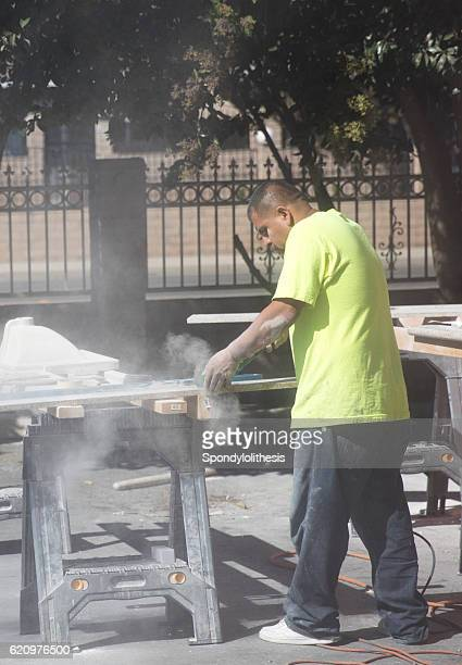 mexican worker cutting granite without any protection - emphysema stock photos and pictures