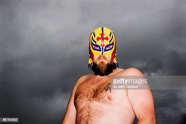 Mexican wrestler in front of clouds