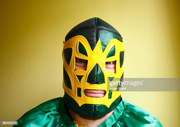 mexican wrestler looking straight at camera - wrestling stock pictures, royalty-free photos & images