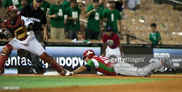 Mexican Yaquis de Obregon's Barbaro Canizares arrives safe on third base in front of catcher Danilo Sanchez of Dominican Republic during the second...
