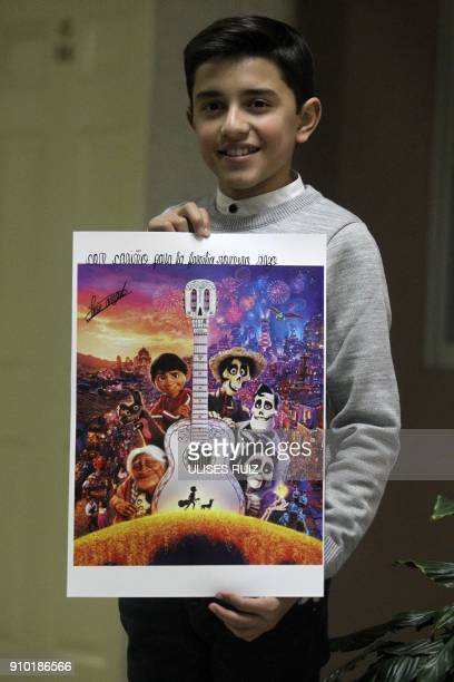 Mexican young singer Luis Angel Jaramillo poses with a poster of DisneyPixar's film Coco before a concert in the framework of the Fair of Villa...