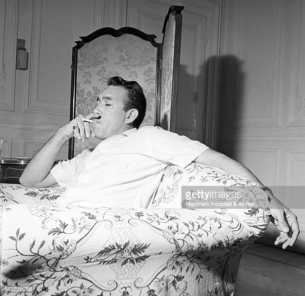 MexicanAmerican actor Anthony Quinn smoking in his house 1957