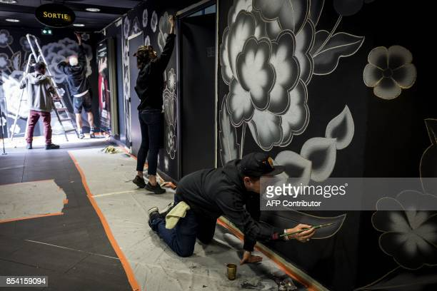 Mexicanamerican artist Jet Martinez paint on the walls of a parking lot during the festival « Wall Drawings Art dans la ville » in Lyon on September...
