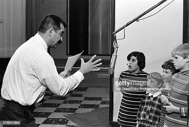 Producer Lee Mendelson directs children who are recording the dialogue for the animated TV special It's the Great Pumpkin Charlie Brown featuring the...
