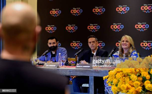 MexicanAmerican Codirector Adrian Molina US Director Lee Unkrich and US Producer Darla K Anderson listen to a question during a press conference on...