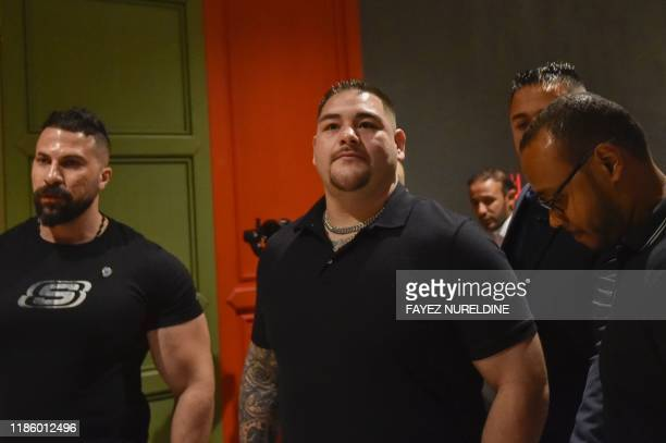 MexicanAmerican heavyweight boxing champion Andy Ruiz Jr arrives for a press conference in the Saudi capital Riyadh on December 2 ahead of the...