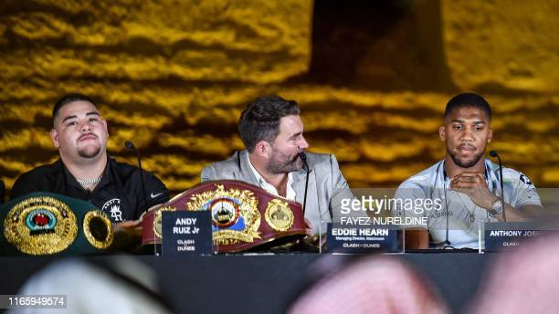 MexicanAmerican heavyweight boxing champion Andy Ruiz Jr British boxing promoter Eddie Hearn and British boxing challenger Anthony Joshua give a...