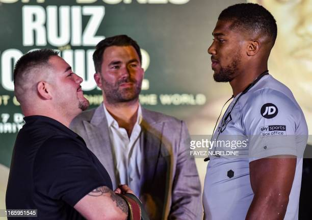 MexicanAmerican heavyweight boxing champion Andy Ruiz Jr faces British boxing challenger Anthony Joshua as British boxing promoter Eddie Hearn stands...