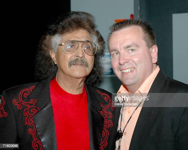 MexicanAmerican singer/guitarist Freddy Fender poses backstage with Route 66 Casino's Entertainment Manager Bob Buhl at Route 66 Casino's Legends...