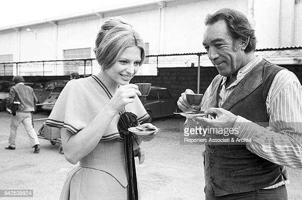 Mexicanborn American actor Anthony Quinn and American actress Pamela Tiffin drinking coffee during a break on the set of Los amigos 1973