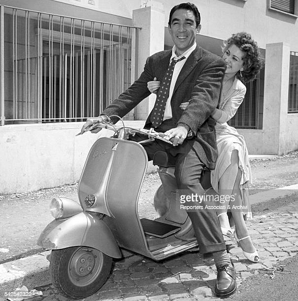 Mexicanborn American actor Anthony Quinn and American actress Sherry Moreland riding a vespa on the set of City Beneath the Sea Rome 1953