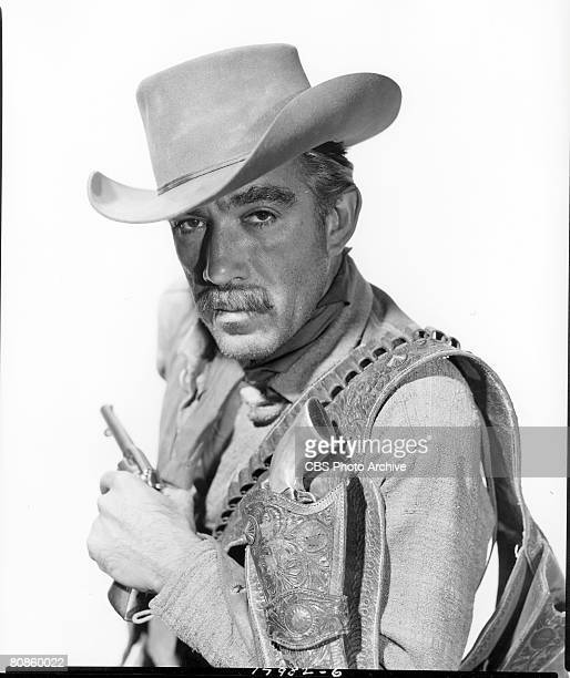 Mexicanborn American actor Anthony Quinn poses with a gun in one hand and an ammunition belt with holster over his shoulder on an episode of the...