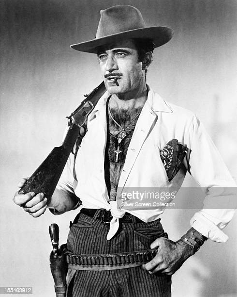 Mexicanborn American actor Gilbert Roland as he appears in 'Bandido' directed by Richard Fleischer 1956 Roland plays Colonel Escobar in the film