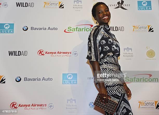 Mexicanborn Oscaraward winning Kenyan actress Lupita Nyong'o poses during a photocall on June 30 2015 at the Villa Rosa Kempinski hotel in Nairobi...