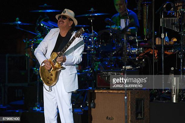 Mexicanborn US guitarist Carlos Santana performs on stage during a concert at the Starlite music festival in Marbella on July 24 2016 / AFP / JORGE...