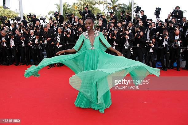 Mexican-Kenyan actress Lupita Nyong'o poses as she arrives for the opening ceremony of the 68th Cannes Film Festival in Cannes, southeastern France,...
