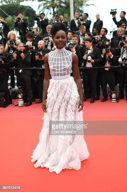 MexicanKenyan actress Lupita Nyong'o poses as she arrives on May 10 2018 for the screening of the film Sorry Angel at the 71st edition of the Cannes...