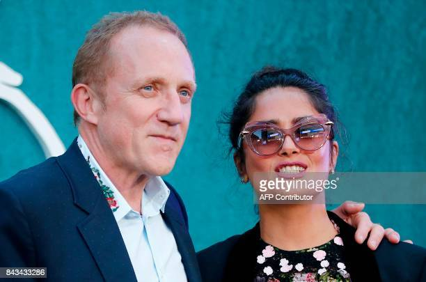 MexicanLebanese actress Salma Hayek and her husband FrancoisHenri Pinault pose for a photograph upon arrival for the UK premiere of the film 'Mother...