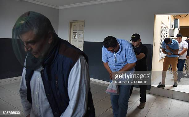 Mexicans Armando Carrillo and Martin Huerta are taken into custody by police after declaring in Asuncion on December 9 2016 Four Mexicans presumably...