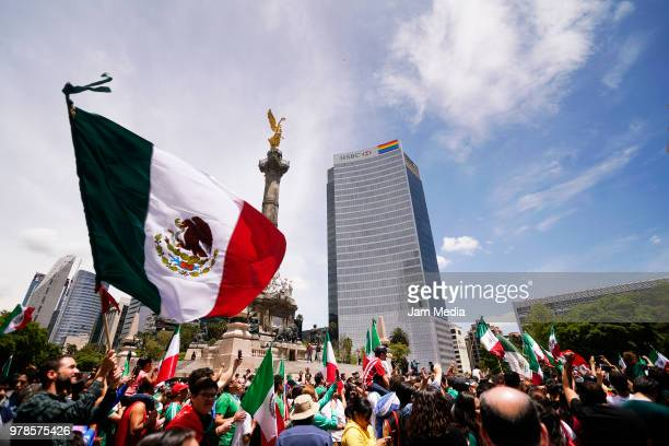 Mexican fans celebrate at a public square after the Mexico National Team victory over Germany in the 2018 FIFA World Cup Russia on June 17 2018 in...