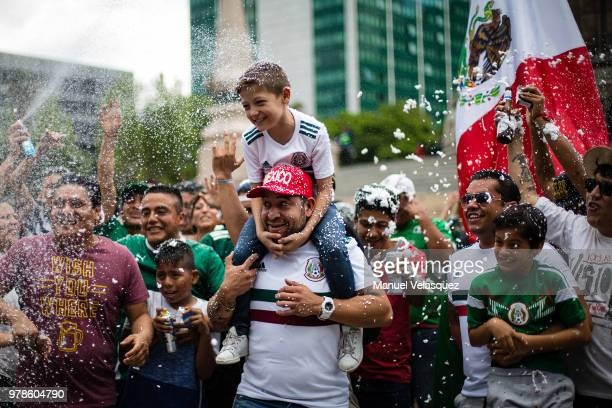 Mexicans celebrate at the Angel of Independence after the Mexico National Team victory over Germany in the 2018 FIFA World Cup Russia on June 17 2018...