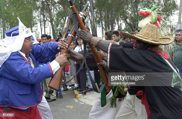 Mexicans celebrate Cinco de Mayo with a reenactment of the 1862 battle between the French and the Zacapuaxtlas Indians May 5 2001 in Puebla Mexico...
