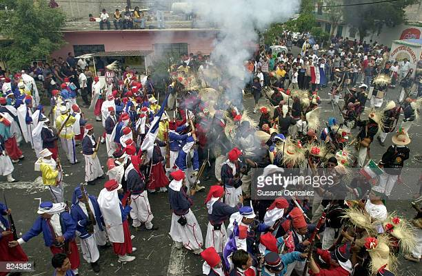 Mexicans celebrate Cinco de Mayo with a reenactment of the 1862 battle between the French and the Zacapuaxtlas Indians May 5, 2001 in Puebla, Mexico....