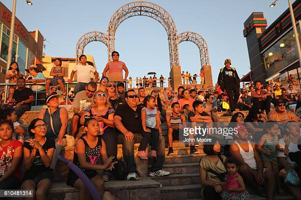 Mexicans enjoy a late afternoon near the USMexico border fence which ends in the Pacific Ocean on September 25 2016 in Tijuana Mexico Friendship Park...