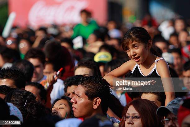 Mexicans gather at Zocalo square to watch a TV broadcast of the Group A match of FIFA 2010 World Cup between Mexico and Uruguay as part of FIFA Fan...