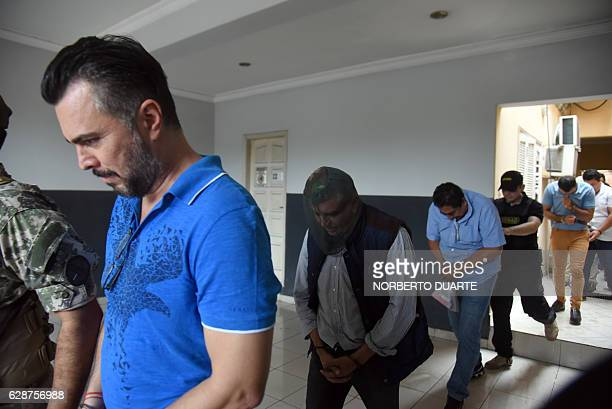 Mexicans Jimmy Waine Galliel Armando Carrillo and Martin Huerta are taken into custody by police after declaring in Asuncion on December 9 2016 Four...