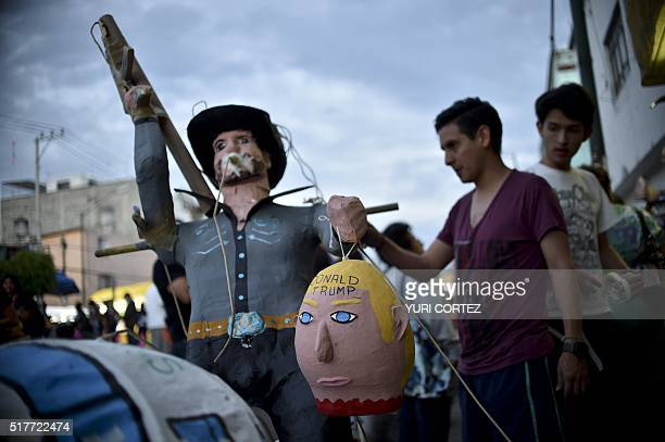 Mexican's prepare to set fire to an effigy depicting US Republican presidential candidate Donald Trump during Holy Week celebrations in Mexico City...