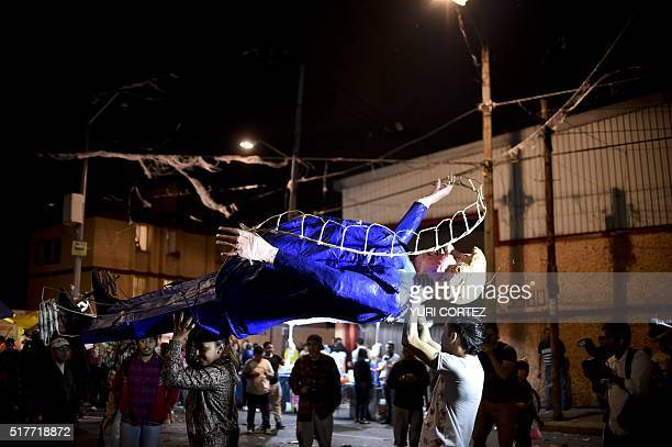 Mexican's prepare to set fire to an effigy of US Republican presidential candidate Donald Trump on March 26 2016 in Mexico City during Holy Week...