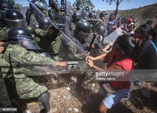 Mexicans protestors clash with police officers to exceed the barricade after Mexico police found dozens of bodies in Acapulco, Mexico on Februay 6,...