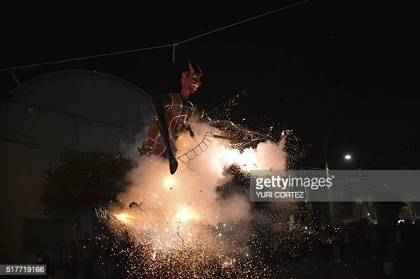 Mexican's set fire a dummy representing the Islamic State group during Holy Week celebrations in Mexico City on March 26 2016 For many years Mexicans...
